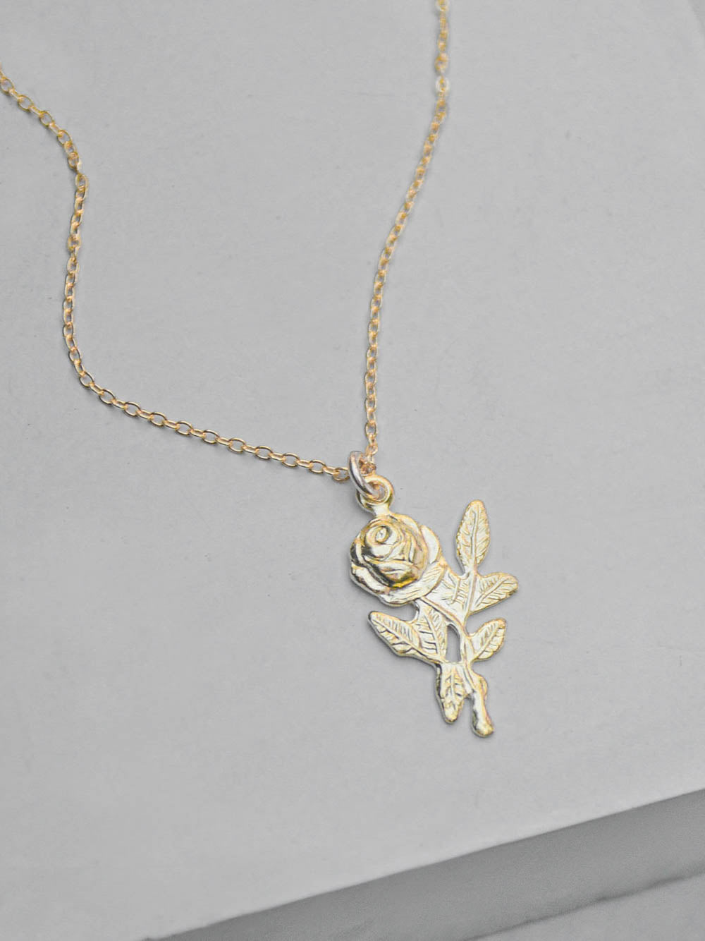 Gold Plated Rose Charm Necklace by The Faint Hearted Jewelry