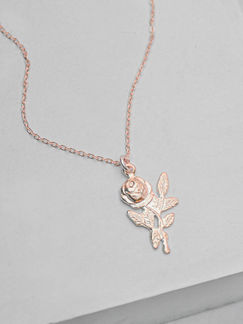 Rose Gold Charm Necklace by The Faint Hearted Jewelry