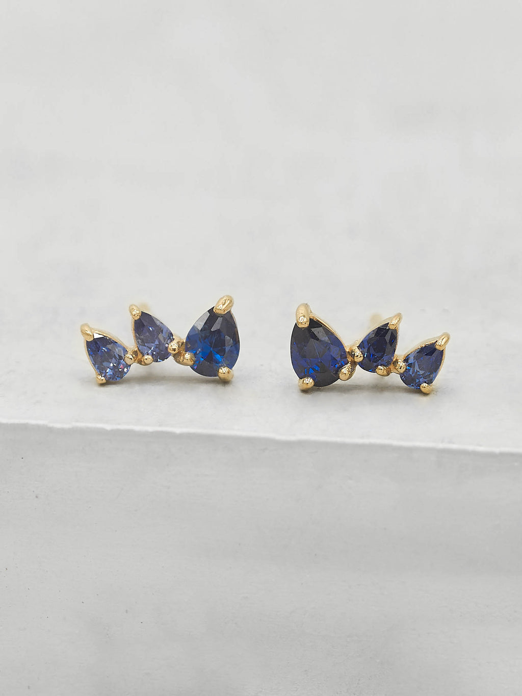 Gold Plated 3 Stones Blue Sapphire Pear Shape Cubic Zirconia CZ  Stud Earrings by The Faint Hearted jewelry
