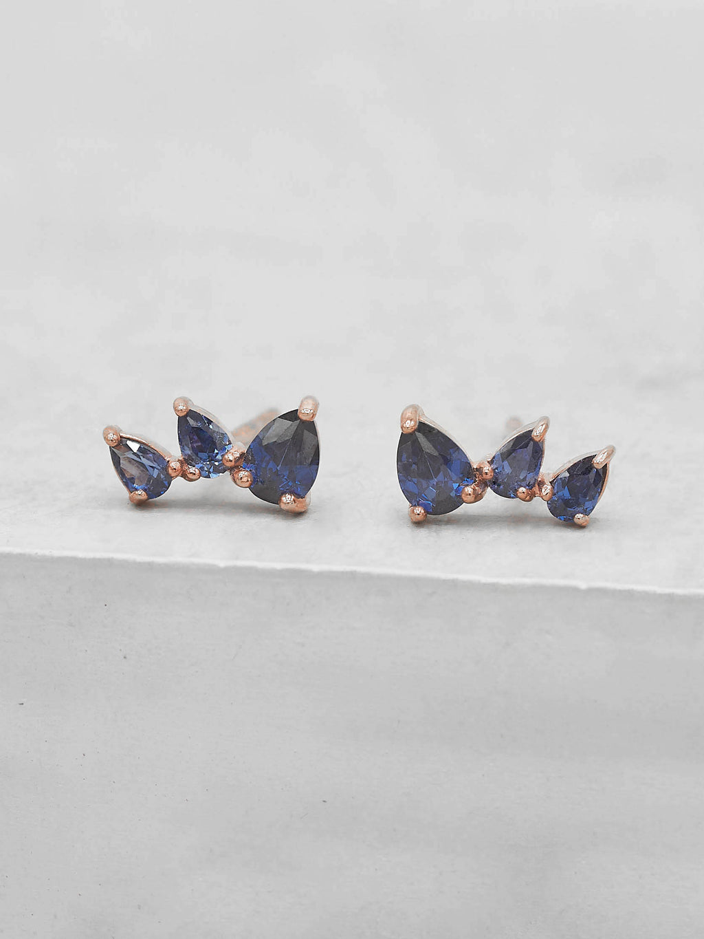 Rose Gold Plated  3 Stones Blue Sapphire Pear Shape Cubic Zirconia CZ Stud Earrings by The Faint Hearted jewelry