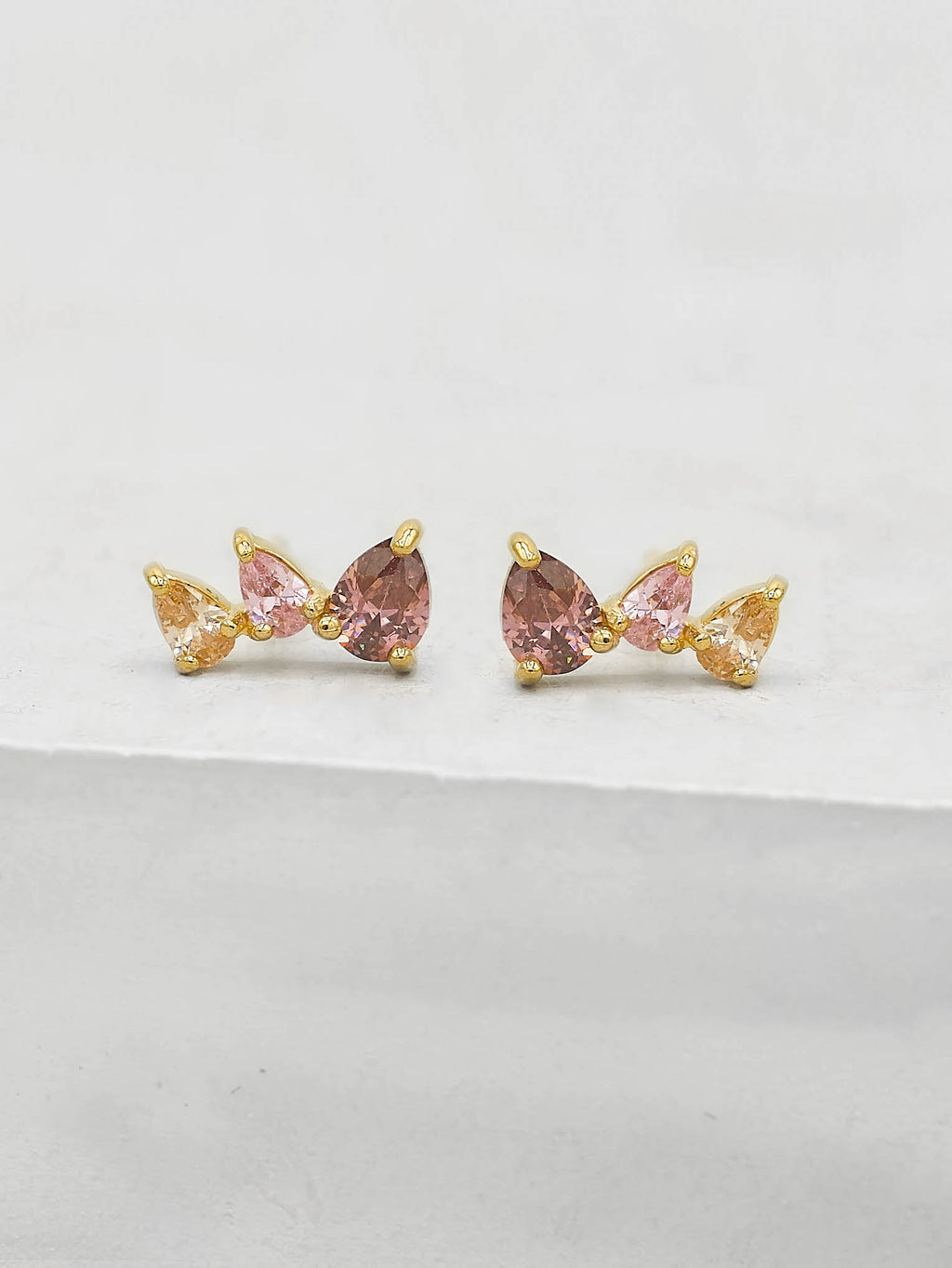 Gold Plated 3 Stones Pink Ruby  Pear Shape Cubic Zirconia CZ Stud Earrings by The Faint Hearted jewelry