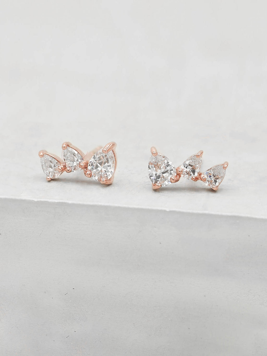Rose Gold Plated  3 Stones White  Pear Shape Cubic Zirconia CZ Stud Earrings by The Faint Hearted jewelry