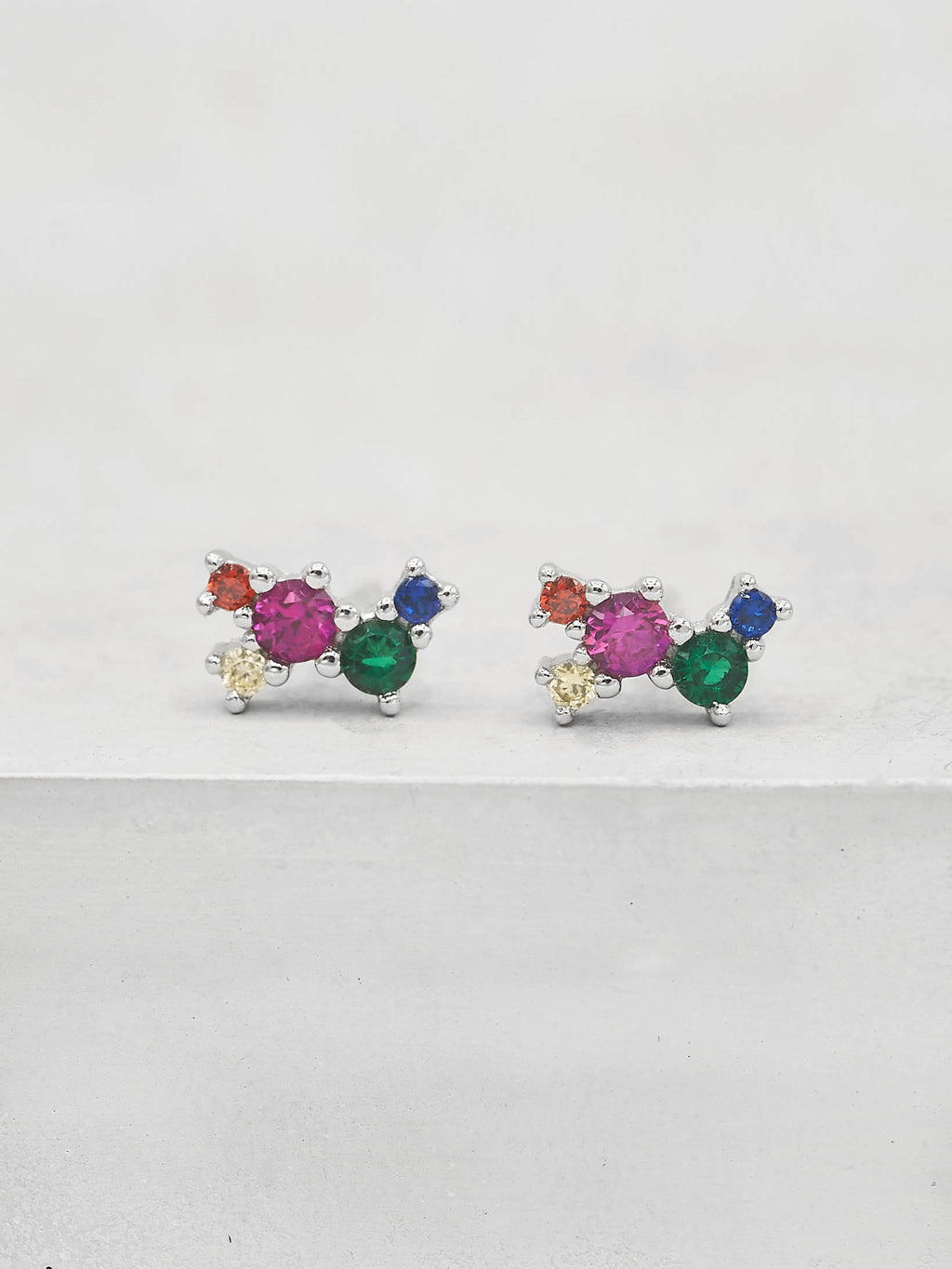 pair of Rhodium Plated Rainbow  CZ Cubic Zirconia Twilight Style Stud dainty Earrings by The Faint Hearted jewelry