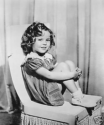 Shirley Temple Holding Legs In Chair  8x10 Photograph