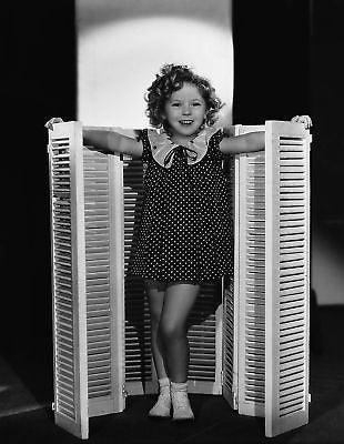 Shirley Temple Standing In Front Of Shutters 8x10 Photograph