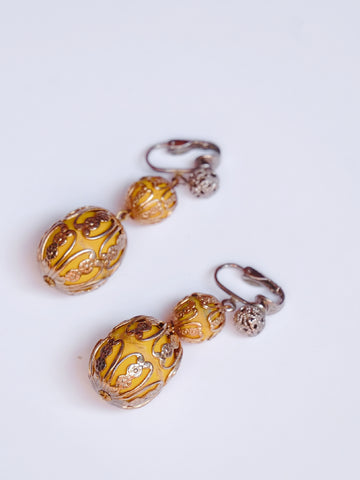 Yellow candy in an engraved box (Vintage Clip-on Earrings)