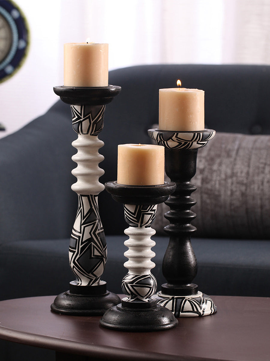 CANDLE HOLDERS<