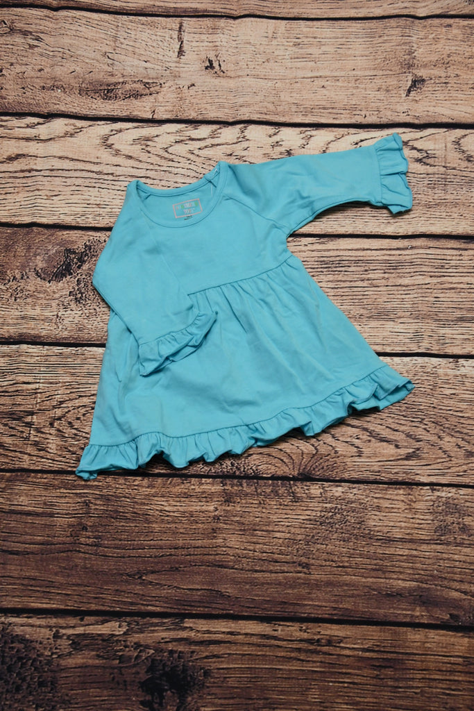 Girl's turquoise long sleeve ruffle swing top with ruffle hem