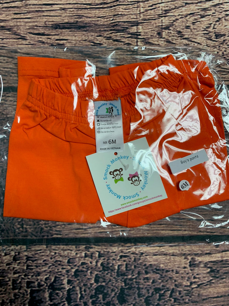 Boy's orange knit pants (6m)