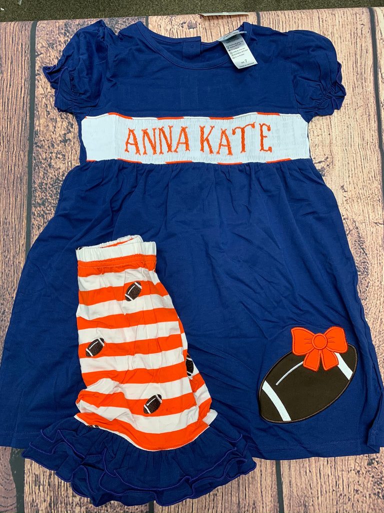 "Girls smocked ""PERSONALIZED"" navy short sleeve shirt with football applique and orange and white embroidered football knit ruffle short set ""ANNA KATE"" (4t)"