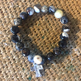 Beaded bracelet with cross charm