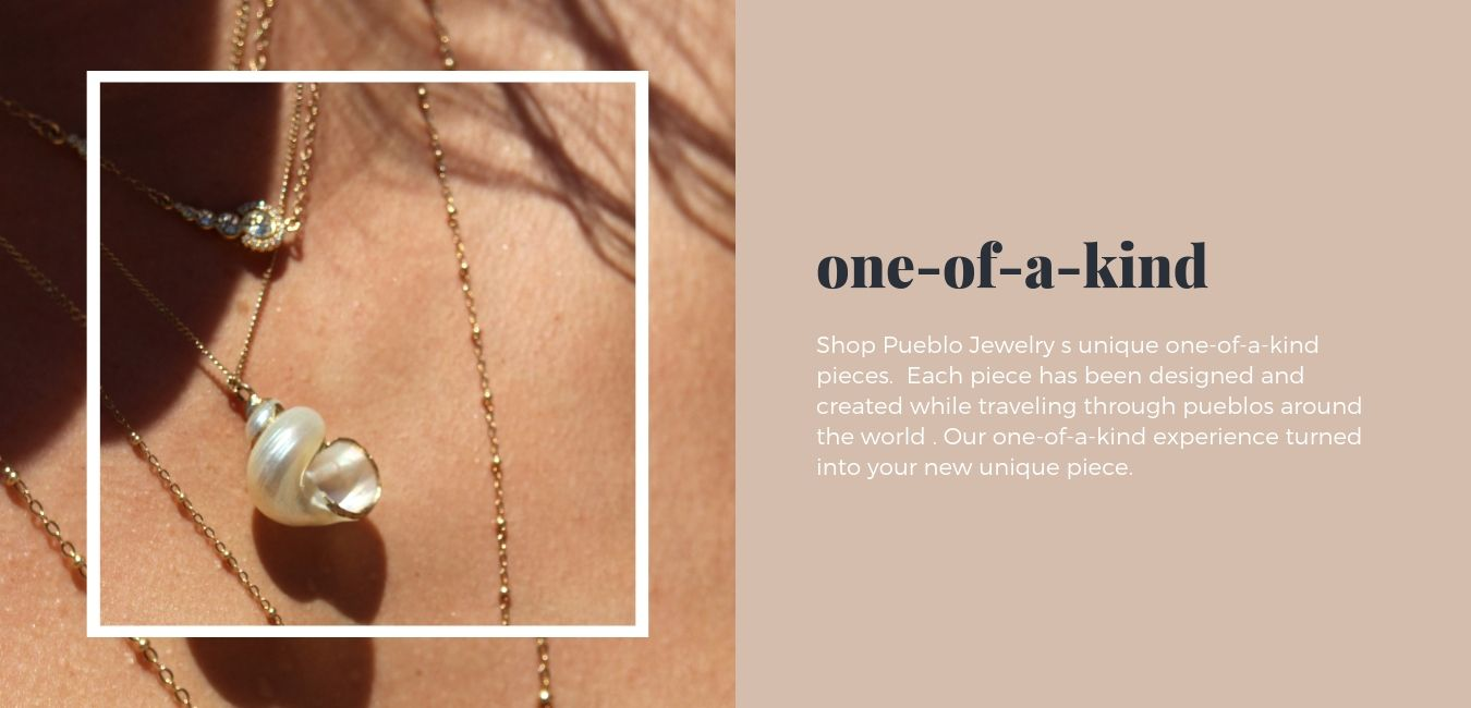 14k gold pendant necklace adorned with a shell.  Part of Pueblo Jewelry's one-of-a-kind collection