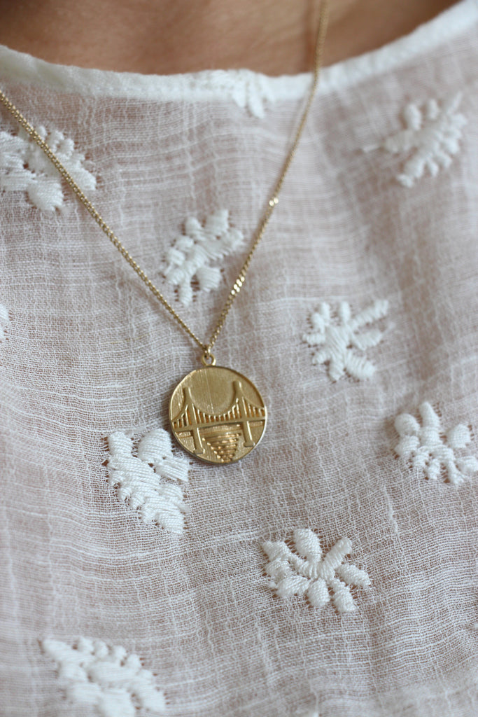 Pueblo Jewelry, in Mansur Gavriel Dress and 14k Gold Plated Coin Necklace
