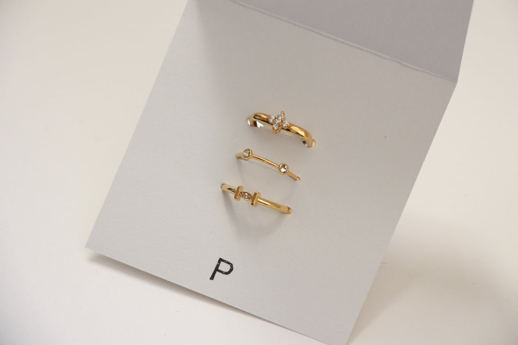 Pueblo Jewelry, three gold rings stacked.  One is a square ring