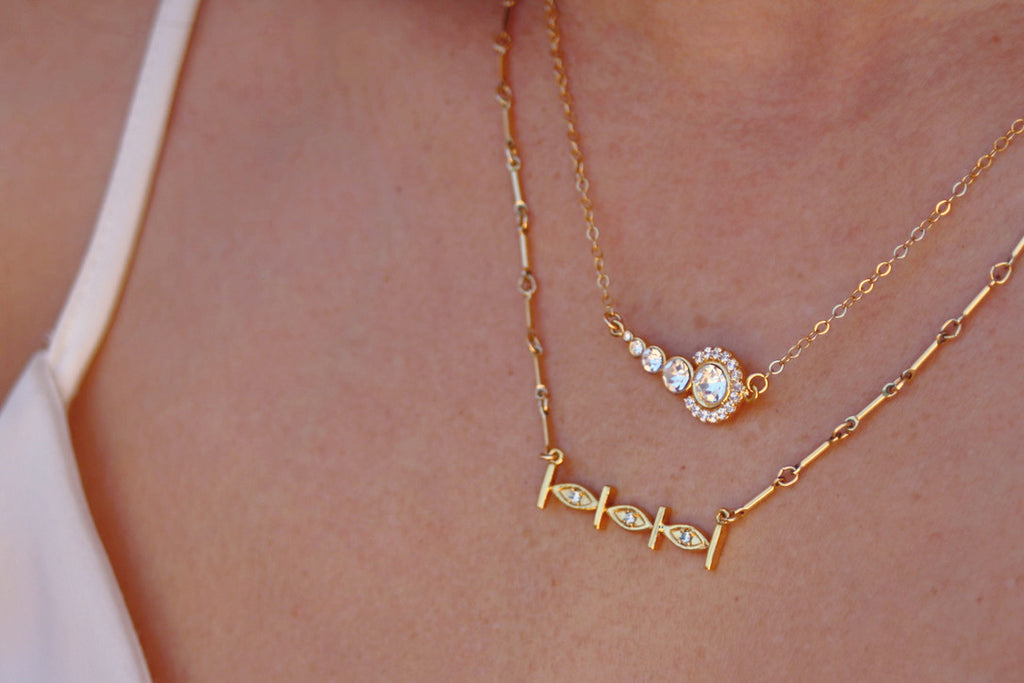 Pueblo Jewelry, two 14k gold necklaces layered with cubic zirconia and swarovski stones
