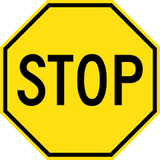 old yellow stop sign