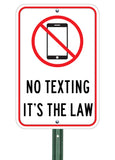 no texting its the law sign on metal post
