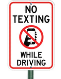 no texting while driving sign on post