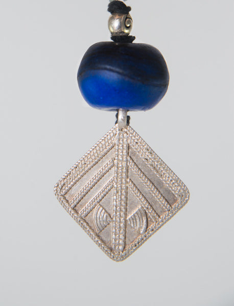 Glass beads and hand made Ethiopian silver pendant