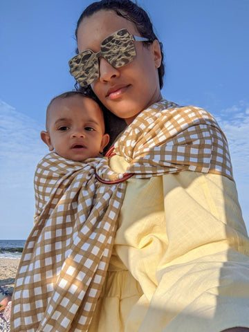 Immy, mom of two rocking the sold out Gingham Sling style from Chekoh Baby Carriers