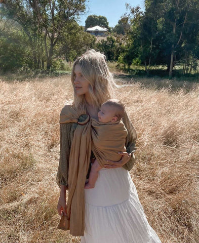 Mady Lee babywearing her daughter Indi in the Chekoh Ring Sling in Camel