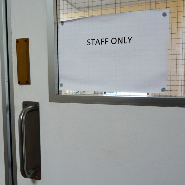 Staff Only hospital and medical facility sign on door