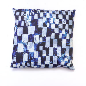 reverse side of black and white couch pillow, blue reverse