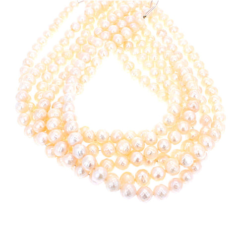 FACETED 8.5-9mm ROUND PEARLS PEACH