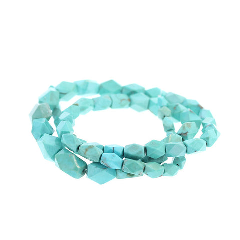 AQUA TURQUOISE FACETED SHAPED BEADS