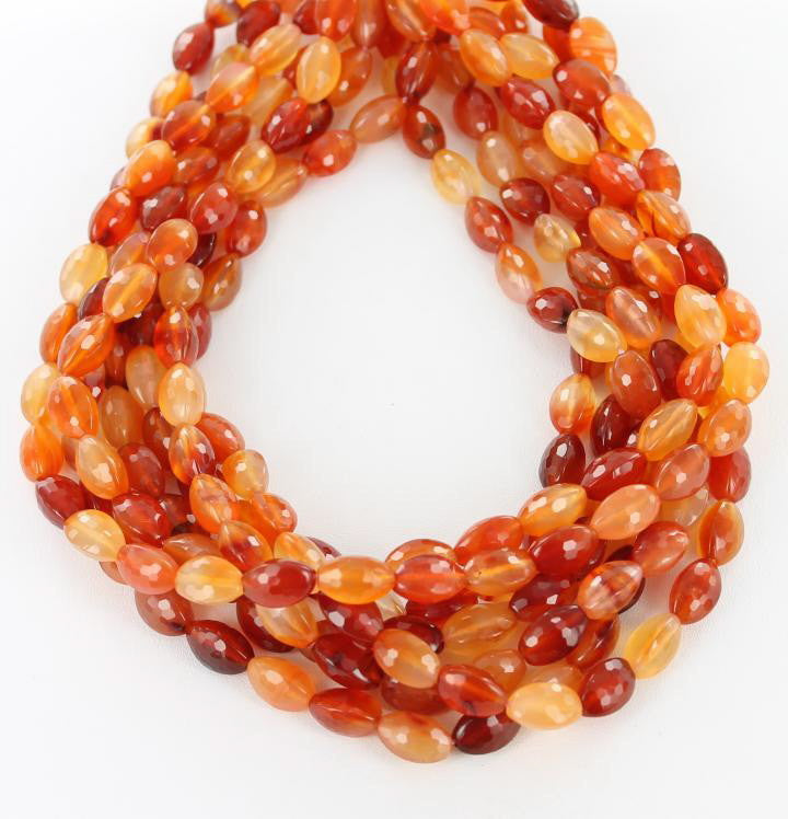 "FACETED CARNELIAN EGG BEADS 8x12mm 16"" - New World Gems"
