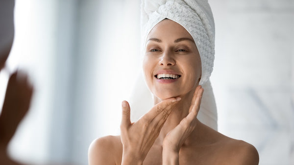 woman mirror beautiful skincare
