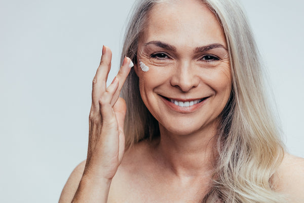 mature woman doing skincare