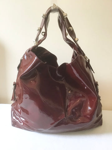 RUSSELL & BROMLEY BURGUNDY PATENT LEATHER SILVER STUD TRIM SHOULDER BAG