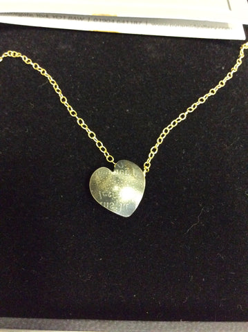 AN ORIGINAL GRACIE MAY OXIDISED SILVER HEART ON A GOLD CHAIN