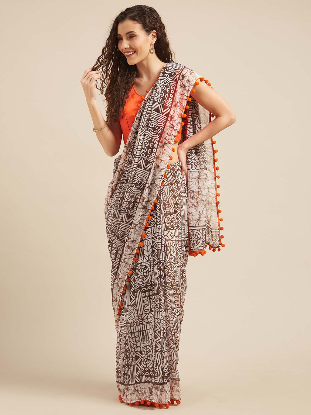 Brown and White Poly Georgette Batik Print Saree With Pom Pom Lace - Riviera Closet