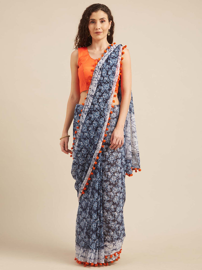 Blue and White Poly Georgette Batik Print Saree With Pom Pom Lace by Tikhi Imli