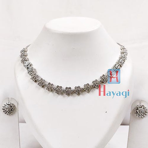 Floral Rhodium Necklace Set With Studd Earrings  _Hayagi(Pune)