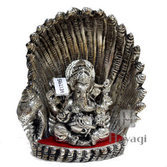 God Ganesh Sitting in Conch Shell Statue Online  - Hayagi