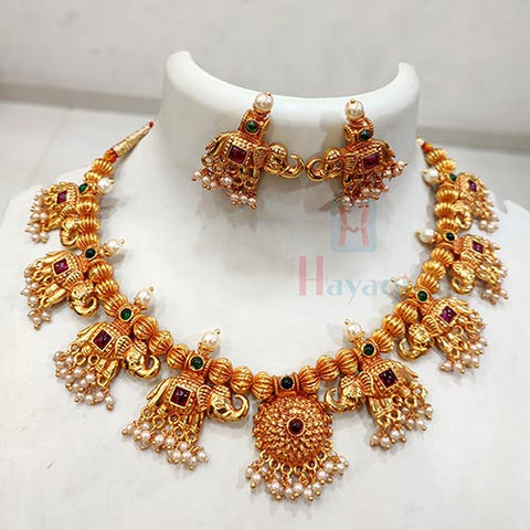 Traditional Wear Thushi Necklace Decorated With 8 Hatti Pendants , Pearl Embellished Necklace  With Earrings Online_Hayagi(Pune)