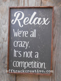 Relax We're All Crazy Painted Sign