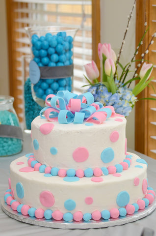 blue and pink gender reveal cake
