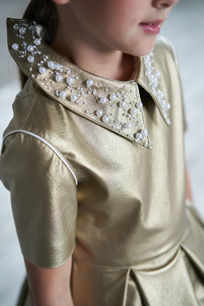 Gold Faux Leather High-Low Girls Dress with White French Lace Trim - LAZY FRANCIS - Shop in store at 406 Kings Road, Chelsea, London or shop online at www.lazyfrancis.com