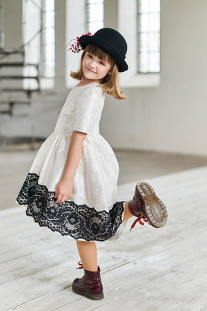 White Raw Silk High-Low Girls Dress with Black Lace - LAZY FRANCIS - Shop in store at 406 Kings Road, Chelsea, London or shop online at www.lazyfrancis.com