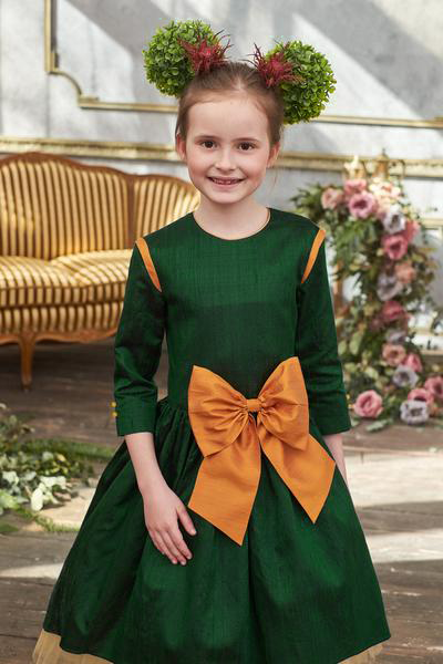 Dark Green Raw Silk High-Low Girls Dress with Gold Bow - LAZY FRANCIS - Shop in store at 406 Kings Road, Chelsea, London or shop online at www.lazyfrancis.com