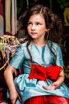Aquamarine Raw Silk High-Low Girls Dress with Lush Red Bow - LAZY FRANCIS - Shop in store at 406 Kings Road, Chelsea, London or shop online at www.lazyfrancis.com