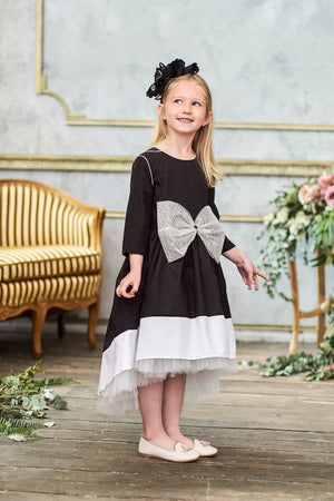 Black High-Low Girls Dress with White Hem and Bow - LAZY FRANCIS - Shop in store at 406 Kings Road, Chelsea, London or shop online at www.lazyfrancis.com