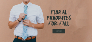 DAZI Floral Tie Worn By A Man With A White Shirt With Words Saying Floral Favorites For Fall Shop Now