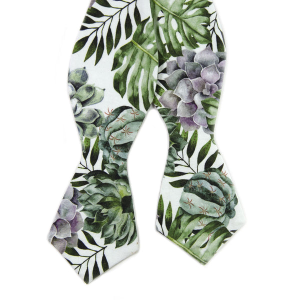 Aloe Self Tie Bow Tie. White background with big green succulents and leaves, and also purple succulents.