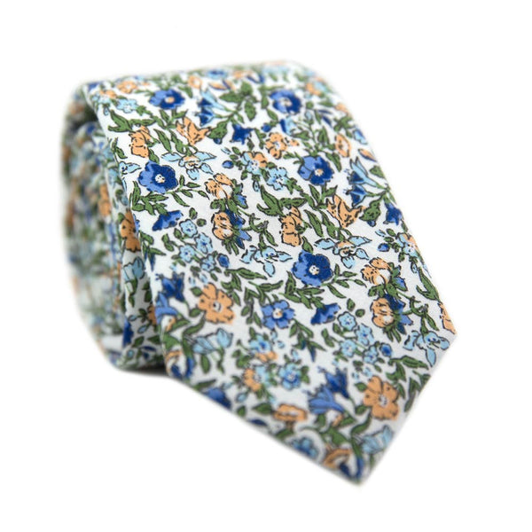 Alpine Blum Skinny Tie. White background with small blue and yellow flowers, small green leaves throughout.