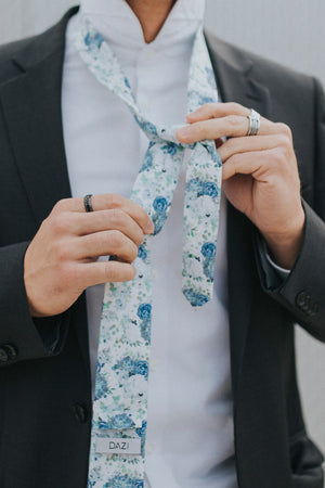 Arctic Ice tie worn with a white shirt and black suit jacket.